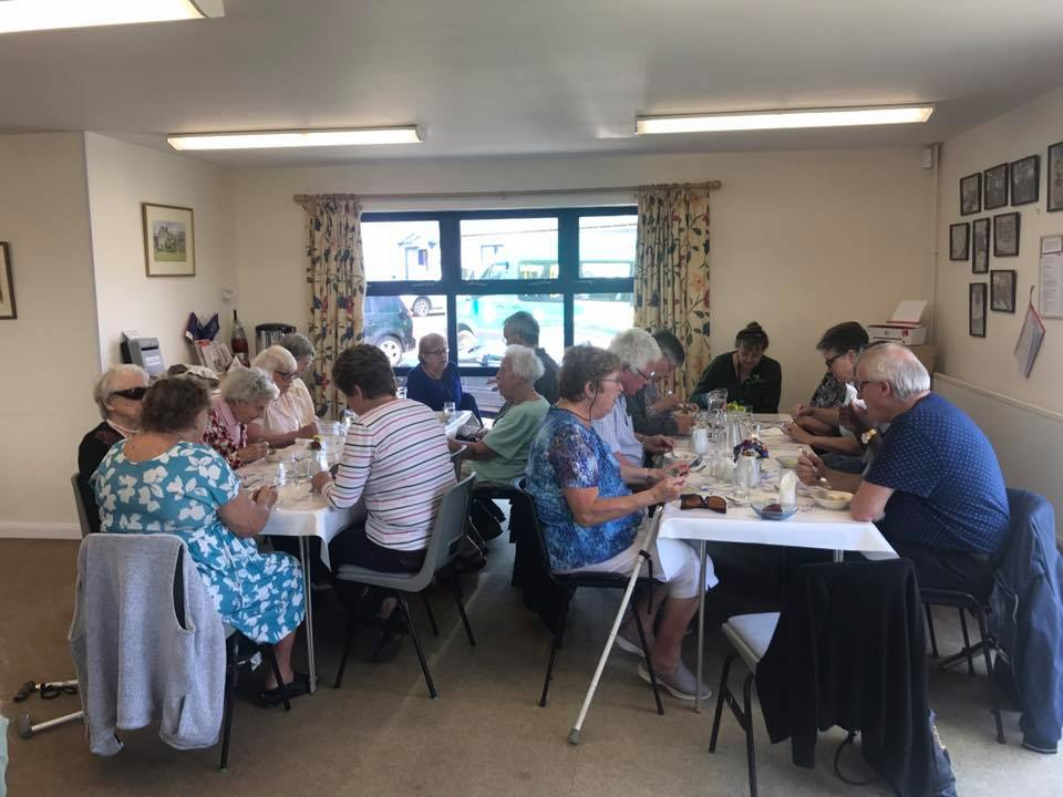 people sat at tables enjoying coffee morning