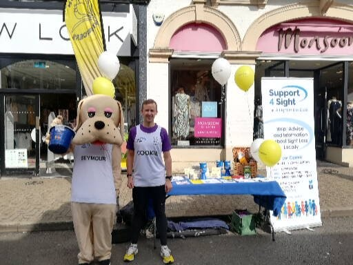 Seymour and a boy on te market square fundraising in saffron walden