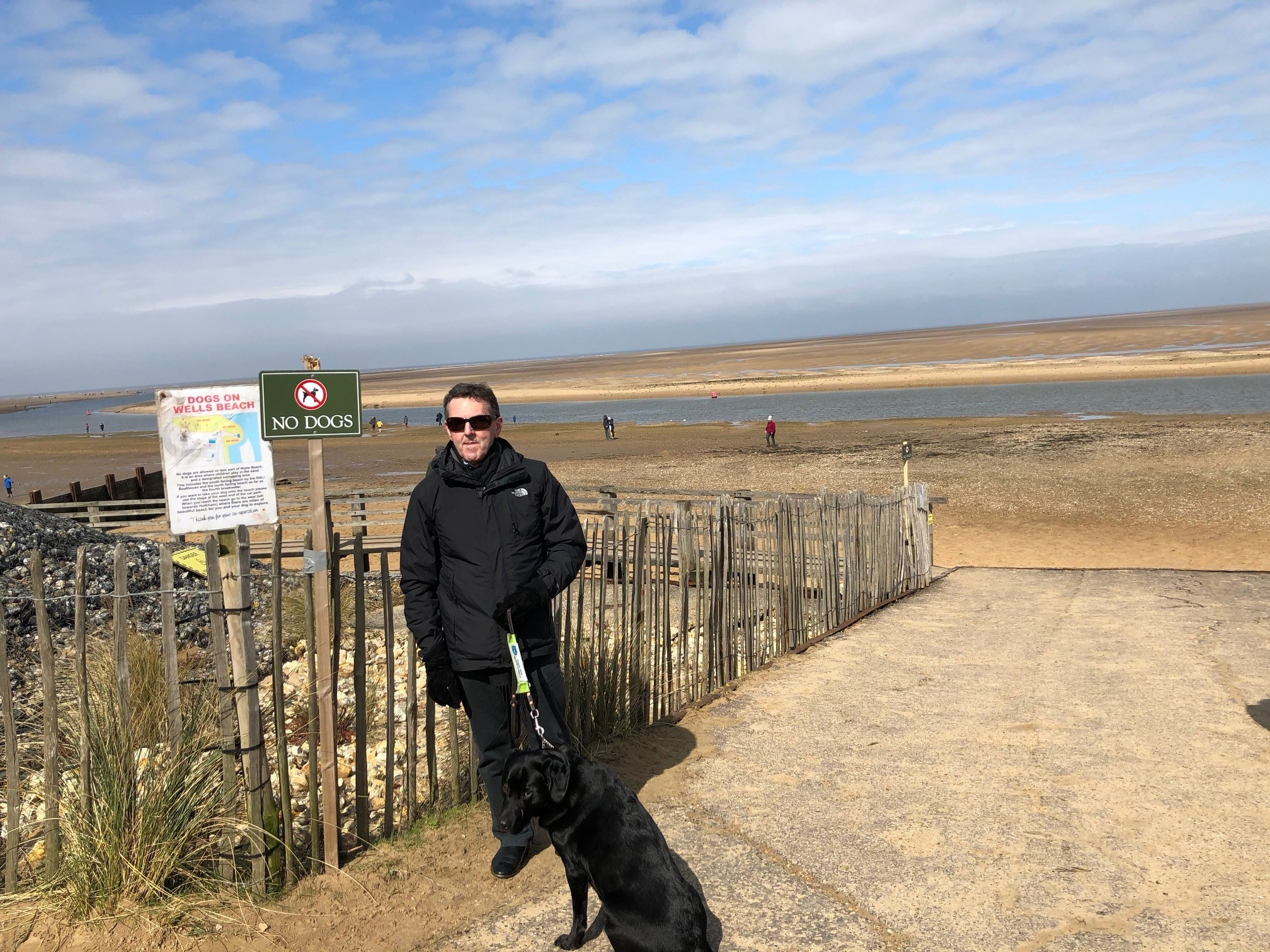 Paul at the beach with Tilly