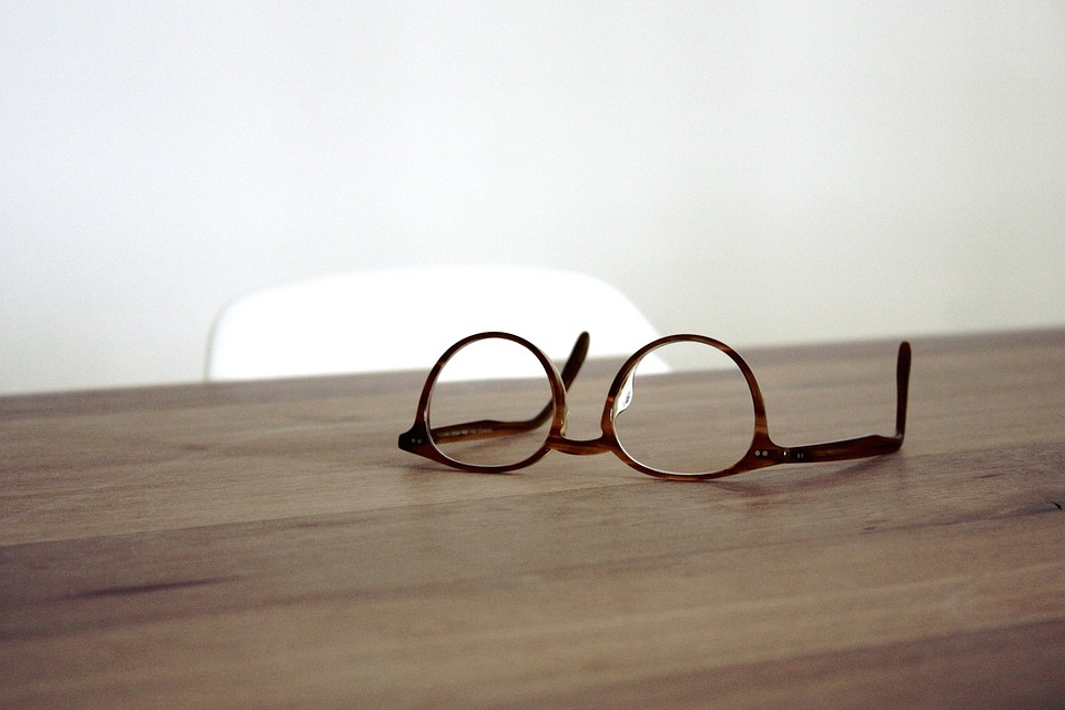 Glasses on a brown desk